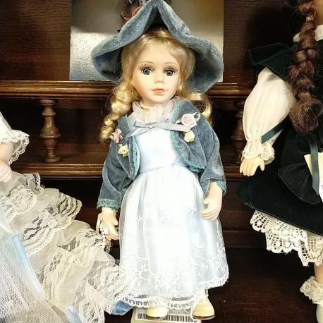 Poupée céramique robe bleue